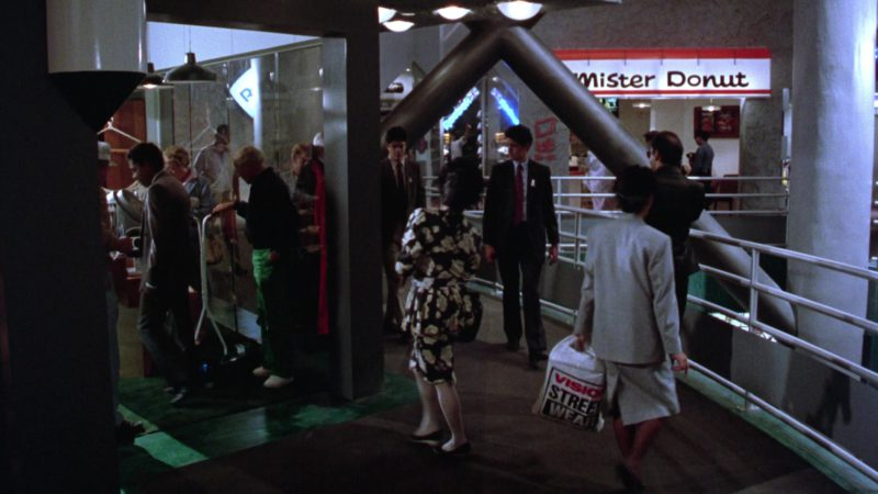 Vision Street Wear Plastic Bag and Mister Donut in Gremlins 2: The New Batch (1990) - Movie Product Placement