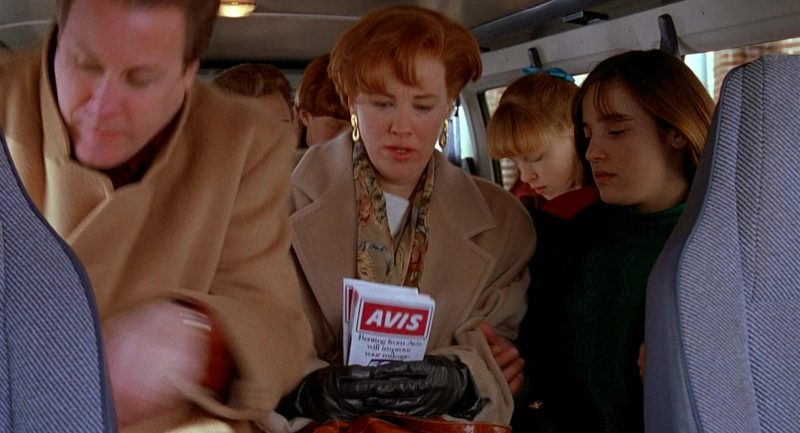 Avis Rent a Car Brochure Held by Catherine O'Hara (Kate McCallister) in Home Alone 2: Lost in New York (1992) Movie Product Placement