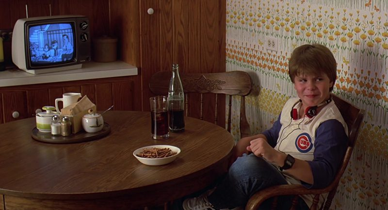 Coca-Cola Bottle and Chicago Cubs Tee Worn by Justin Henry in Sixteen Candles (1984) - Movie Product Placement
