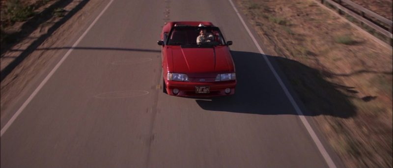 Ford Mustang Red Convertible Car in Road House (1989) - Movie Product Placement