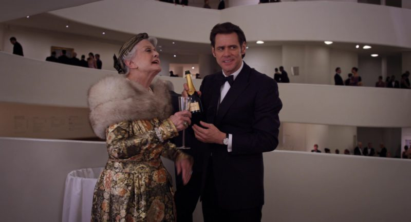 Krug Champagne Held by Jim Carrey in Mr. Popper's Penguins (2011) Movie Product Placement