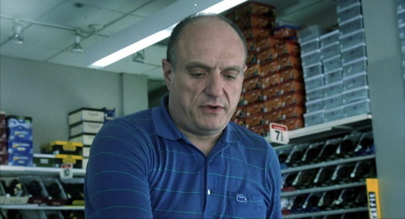 Lacoste Blue Polo Shirt Worn by Stanley DeSantis in I Am Sam (2001) Movie Product Placement