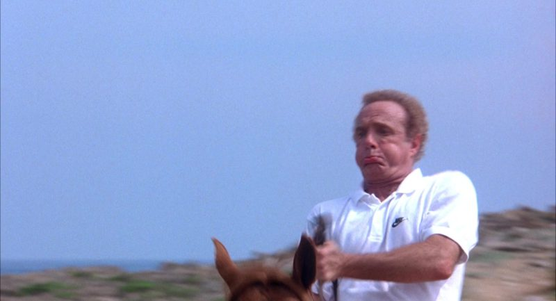 Nike White Short Sleeve Shirt Worn by James Caan in Honeymoon in Vegas (1992) Movie Product Placement