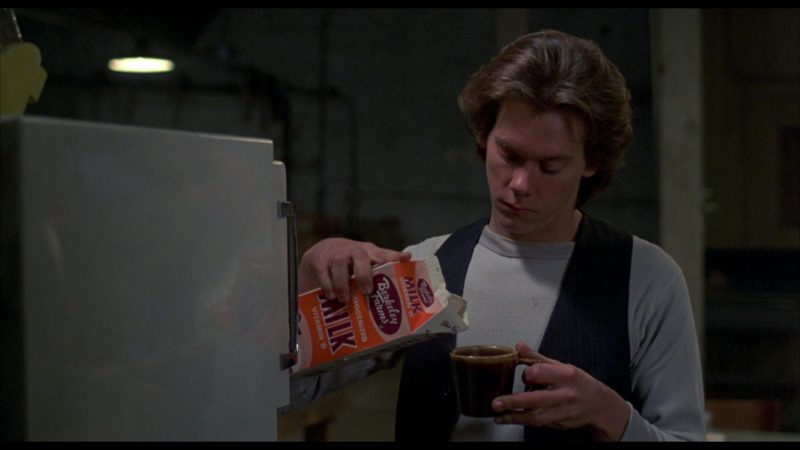 Berkeley Farms Milk Held by Kevin Bacon in Quicksilver (1986) Movie Product Placement