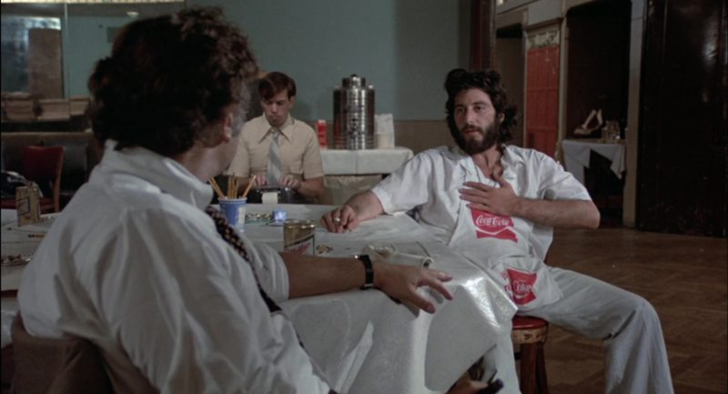 Miller Beer and Coca-Cola Apron in Serpico (1973) Movie Product Placement