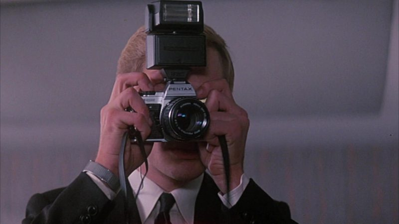 Pentax Camera in Head Office (1985) Movie Product Placement