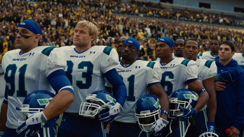 Schutt Helmets and Under Armour Jerseys, Gloves and Hats in The Dark Knight Rises (2012) - Movie Product Placement