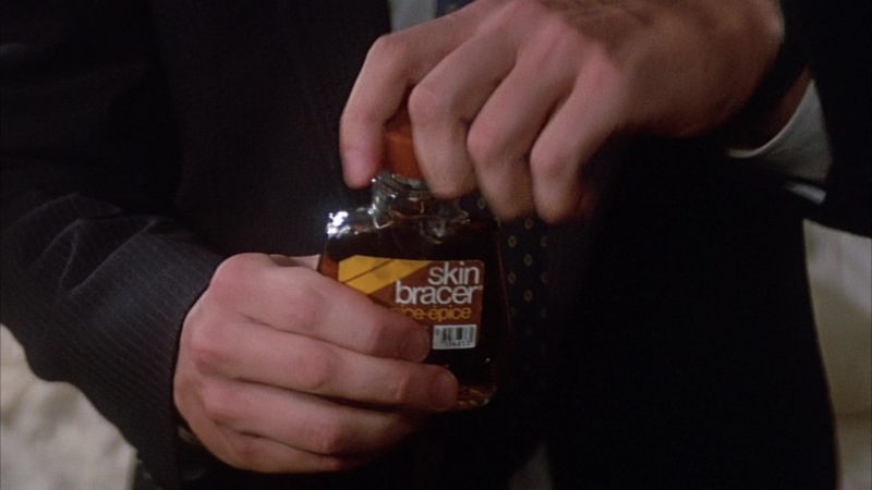 Skin Bracer After Shave in Head Office (1985) Movie Product Placement