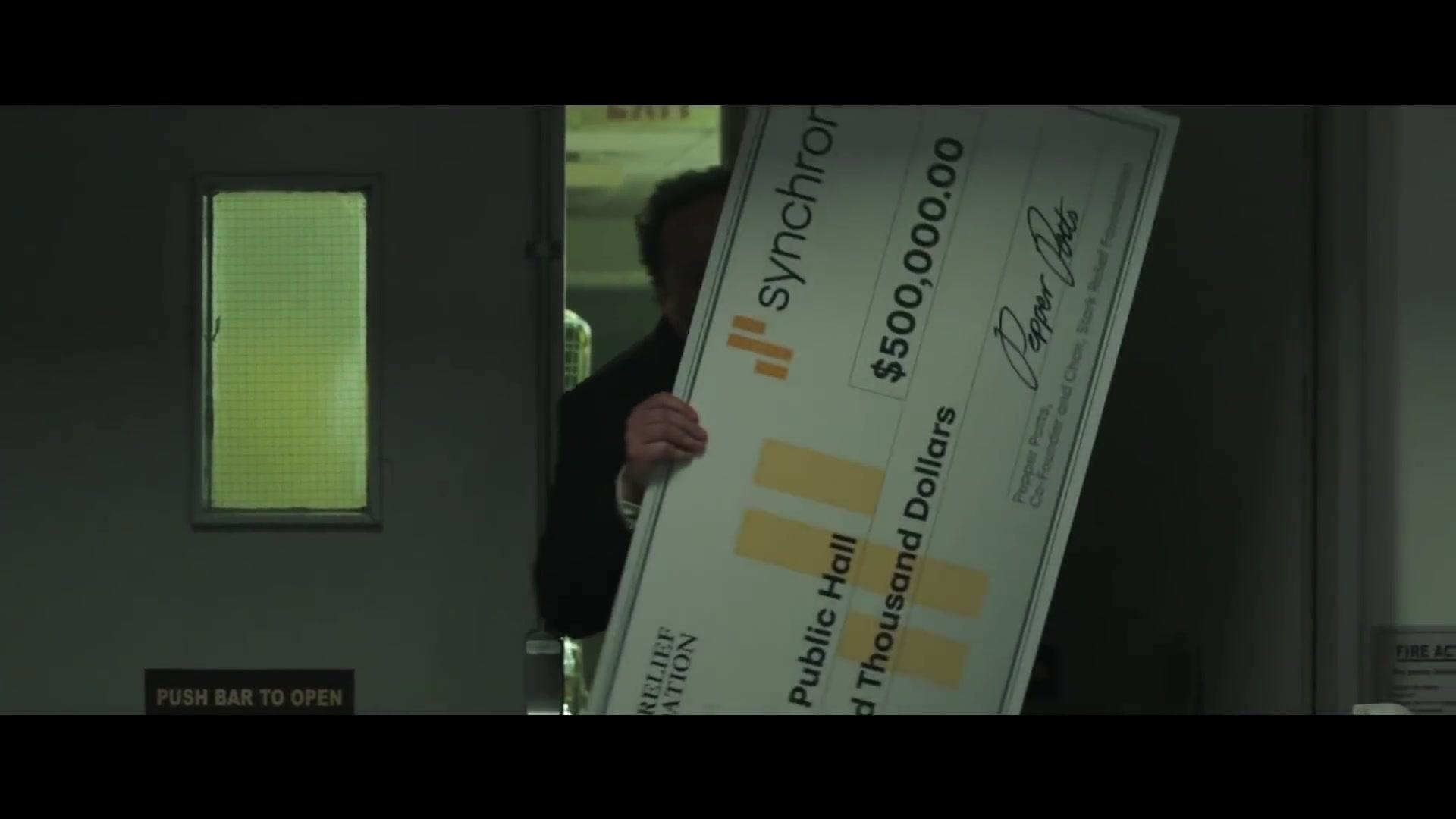 synchrony bank big check held by jon favreau in spider