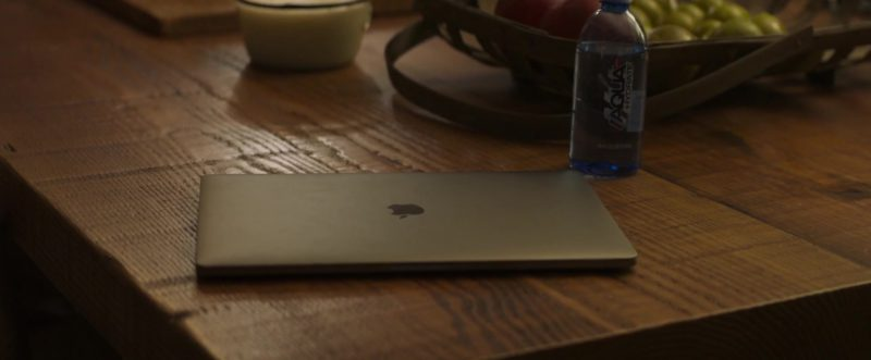 Apple MacBook Laptop and AQUAhydrate Water Bottle in Instant Family (2018) - Movie Product Placement