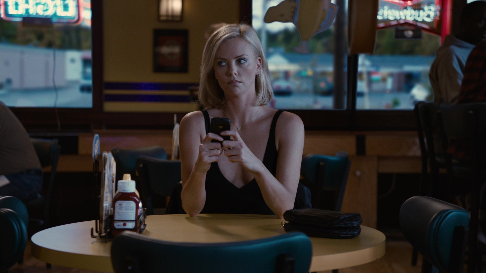 Blackberry Cell Phone Used by Charlize Theron in Young Adult (2011)