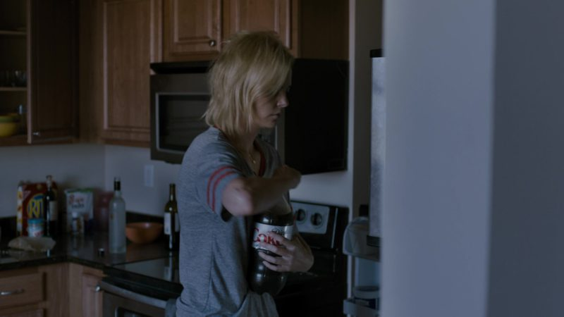 Diet Coke Bottle Held by Charlize Theron in Young Adult (2011) Movie Product Placement