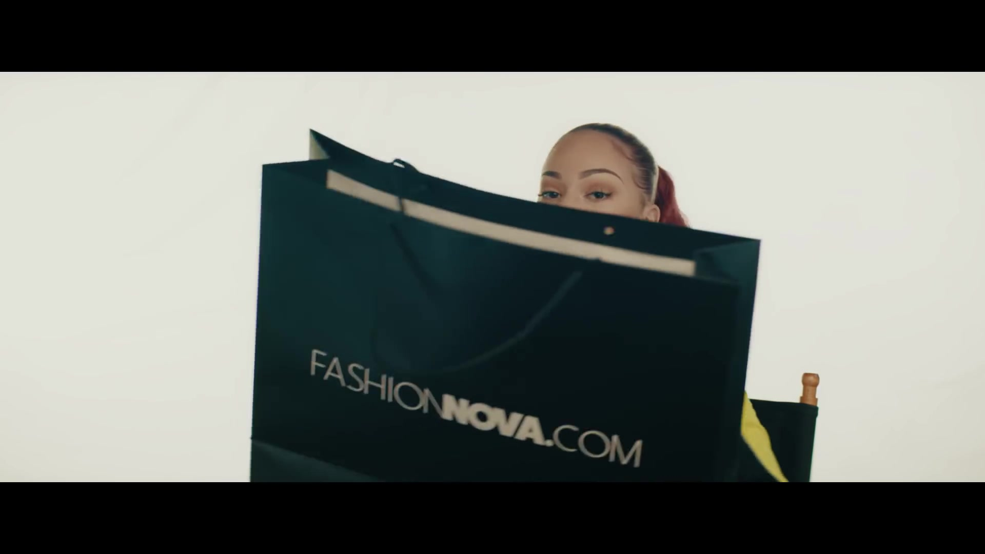 FashionNova Online Store Black Paper Bag Held by Bhad Bhabie