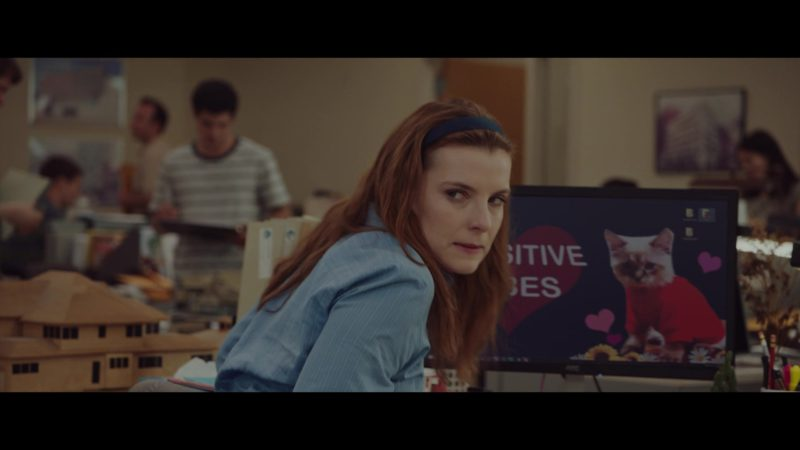 AOC Monitor Used by Betty Gilpin in Isn't It Romantic (2019) - Movie Product Placement