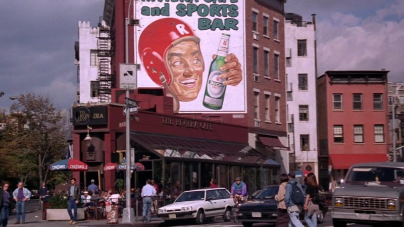 """Beck's Beer Billboard and Cinzano Umbrellas in Friends Season 5 Episode 21 """"The One With the Ball"""" (1999) - TV Show Product Placement"""
