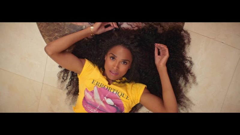 "Errortique Cropped Yellow Tongue & Lips Print Tee Worn by Ciara in ""Thinkin Bout You"" (2019) - Official Music Video Product Placement"