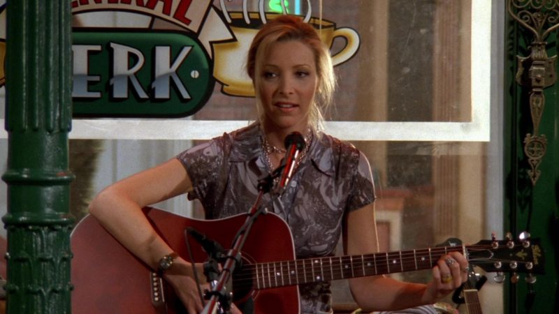 """Gibson Guitar Held by Lisa Kudrow (Phoebe Buffay) in Friends Season 3 Episode 23 """"The One with Ross's Thing"""" (1997) - TV Show Product Placement"""