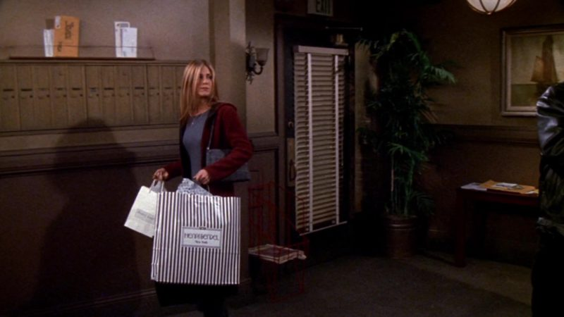 "Henri Bendel Store Paper Bag Held by Jennifer Aniston (Rachel Green) in Friends Season 5 Episode 6 ""The One With the Yeti"" (1998) TV Show Product Placement"