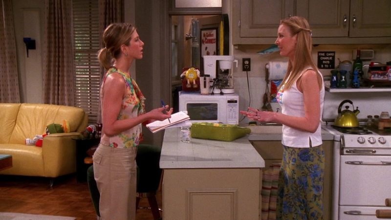 """M&M's Yellow Candy Toy in Friends Season 7 Episode 19 """"The One With Ross and Monica's Cousin"""" (2001) - TV Show Product Placement"""
