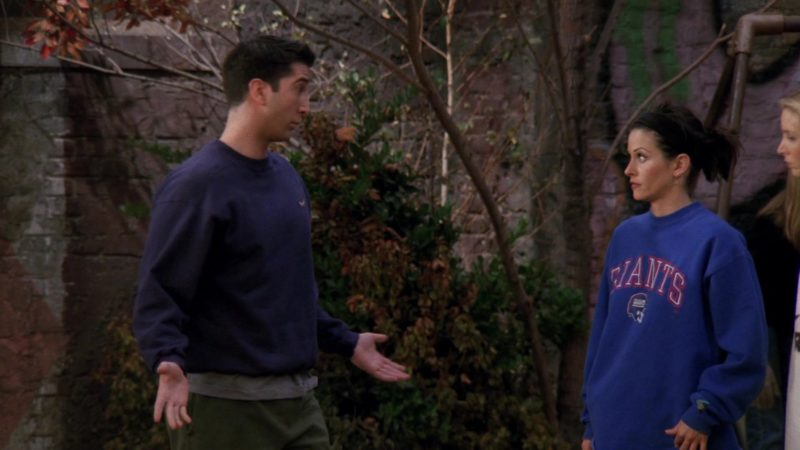 "New York Giants American Football Team Blue Sweatshirt Worn by Courteney Cox (Monica Geller) in Friends Season 3 Episode 9 ""The One with the Football"" (1996) - TV Show Product Placement"