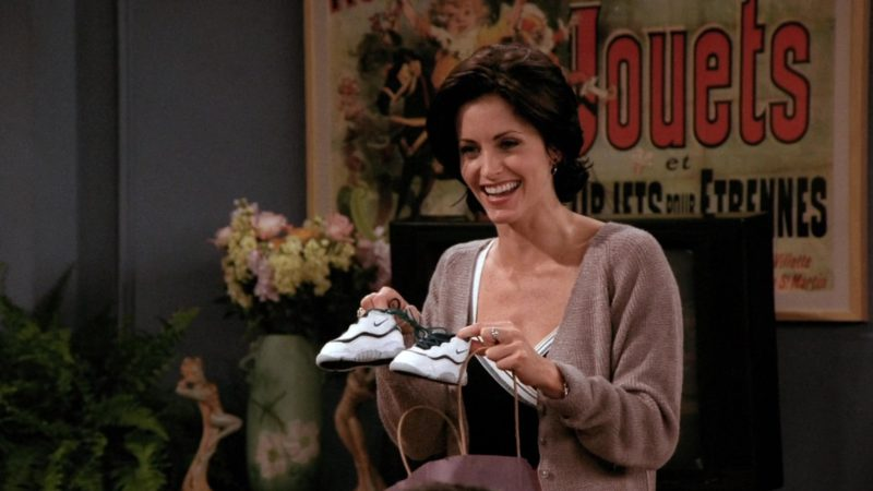 """Nike Baby Boy's Sneakers Held by Courteney Cox (Monica Geller) in Friends Season 2 Episode 1 """"The One with Ross's New Girlfriend"""" (1995) - TV Show Product Placement"""
