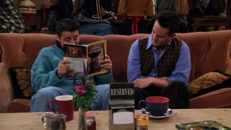 "Nike Sweatshirt and National Geographic Magazine Held by Matt LeBlanc (Joey Tribbiani) in Friends Season 5 Episode 7 ""The One Where Ross Moves In"" (1998) - TV Show Product Placement"