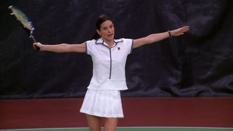 """Nike Women's Tennis Shirt and Nike White Sports Skirt Worn by Courteney Cox (Monica Geller) in Friends Season 5 Episode 12 """"The One with Chandler's Work Laugh"""" (1999) TV Show Product Placement"""