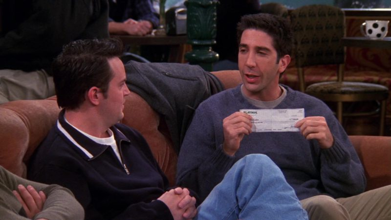 """Playboy Check Payment Held by David Schwimmer (Ross Geller) in Friends Season 6 Episode 12 """"The One With the Joke"""" (2000) - TV Show Product Placement"""