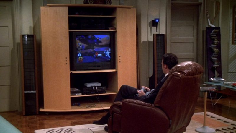 """Sony PlayStation Home Video Game Console Used by Matthew Perry (Chandler Bing) in Friends Season 7 Episode 1 """"The One With Monica's Thunder"""" (2000) - TV Show Product Placement"""