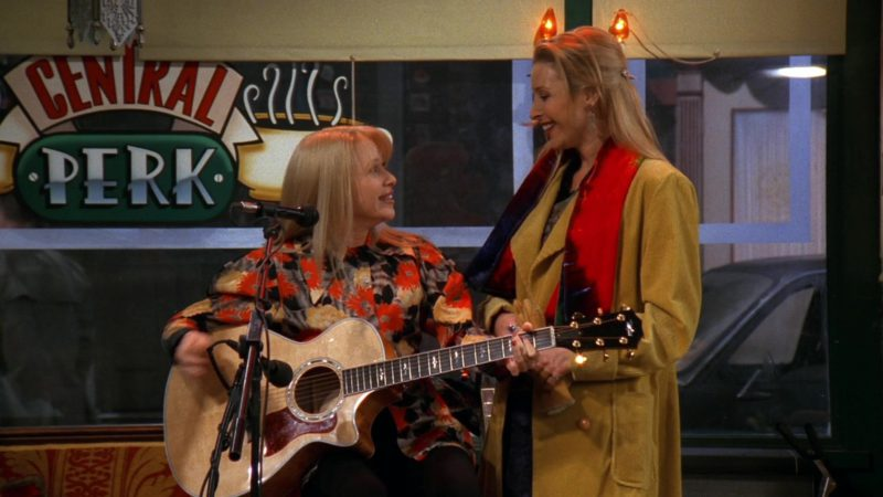 "Taylor Guitar Used by Elizabeth Daily in Friends Season 3 Episode 14 ""The One with Phoebe's Ex-Partner"" (1997) - TV Show Product Placement"