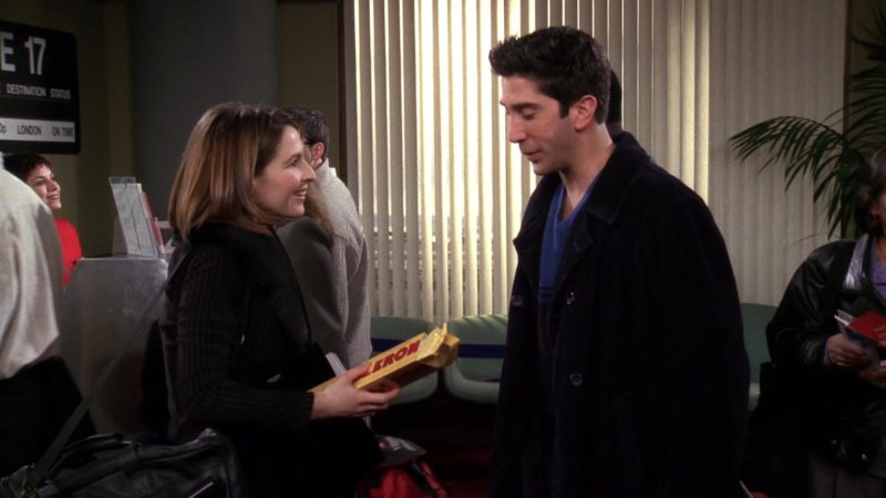 """Toblerone Chocolate Held by Helen Baxendale (Emily Waltham) in Friends Season 4 Episode 18 """"The One with Rachel's New Dress"""" (1998) - TV Show Product Placement"""