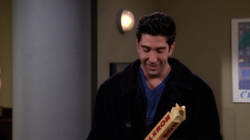 "Toblerone Chocolate held by David Schwimmer (Ross Geller) in Friends Season 4 Episode 18 ""The One with Rachel's New Dress"" (1998) - TV Show Product Placement"