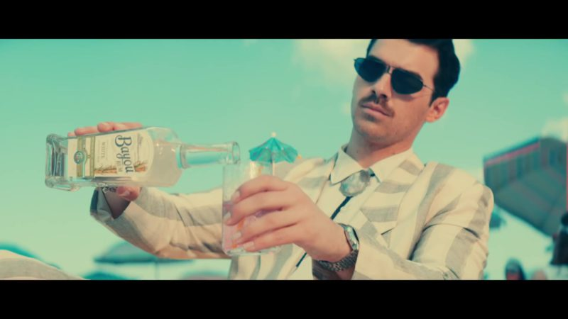 """Bayou White Rum Drunk by Joe Jonas in """"Cool"""" by Jonas Brothers (2019) Official Music Video Product Placement"""