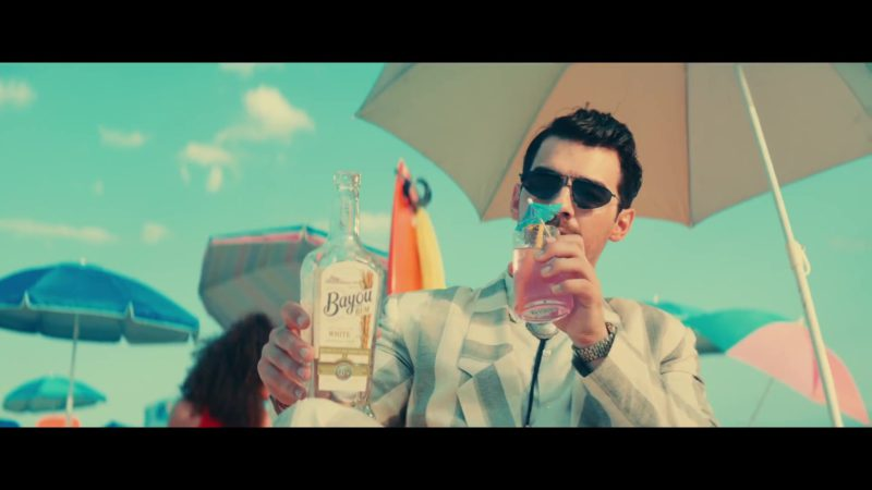 """Bayou White Rum Drunk by Joe Jonas in """"Cool"""" by Jonas Brothers (2019) - Official Music Video Product Placement"""