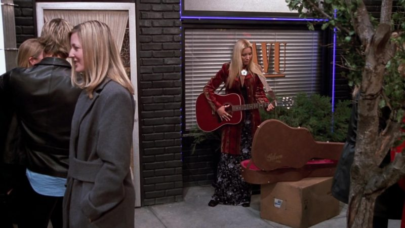 """Gibson Acoustic Guitar and Brown Case Used by Lisa Kudrow (Phoebe Buffay) in Friends Season 9 Episode 19 """"The One With Rachel's Dream"""" (2003) - TV Show Product Placement"""
