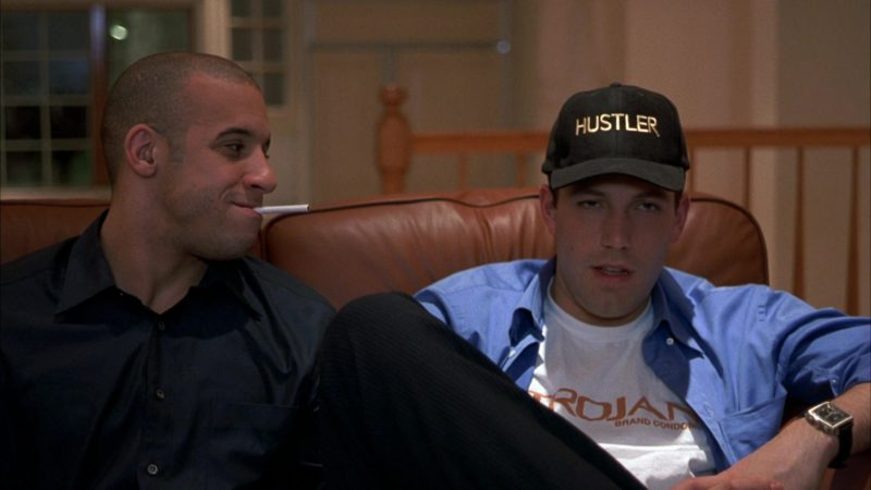 Hustler Cap and Trojan T-Shirt Worn by Ben Affleck in Boiler Room (2000) - Movie Product Placement