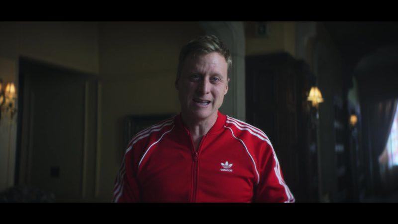 Adidas Jacket (Red) Worn by Alan Tudyk (Mr. Nobody) in Doom Patrol - Season 1, Episode 14, Penultimate Patrol (2019) TV Show Product Placement