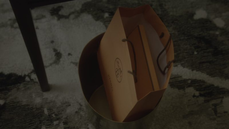 Hermes Orange Paper Bag in What/If - Season 1, Episode 3, What Happened (2019) - TV Show Product Placement