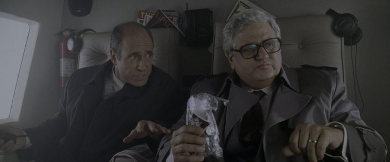 Hershey's Kisses Chocolate Candies Held by Michael Lerner in Godzilla (1998) - Movie Product Placement