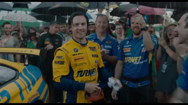 Turner Motorsport, BMW, Continental, Sparco, H&R Springs, Katerra (Racing Suit Worn by Milo Ventimiglia) in The Art of Racing in the Rain (2019) - Movie Product Placement