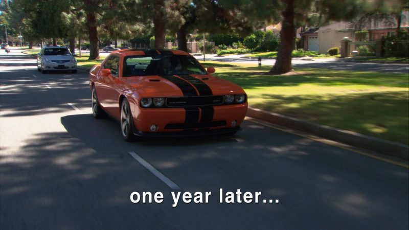 """Dodge Challenger SRT-8 Orange Car Used by Rainn Wilson (Dwight Schrute) in The Office – Season 9, Episodes 24-25, """"Finale"""" (2013) TV Show Product Placement"""