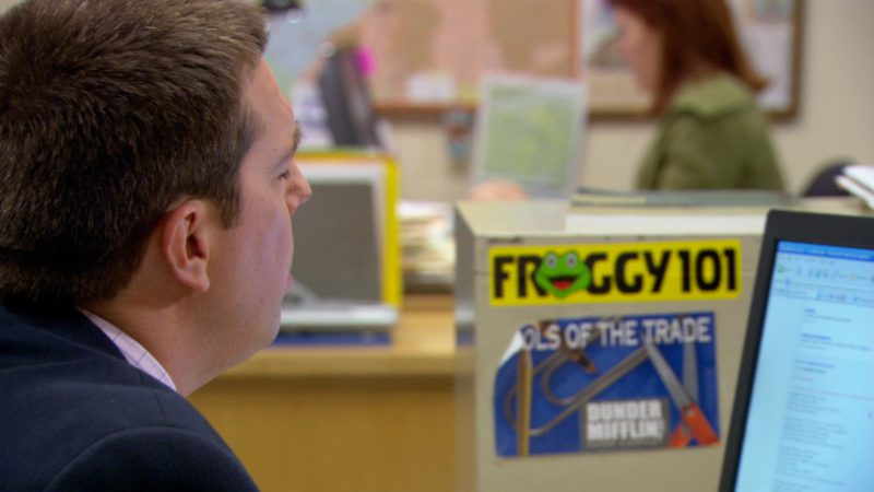 """Froggy 101 Radio Station Sticker in The Office – Season 3, Episode 14, """"The Return"""" (2007) TV Show Product Placement"""
