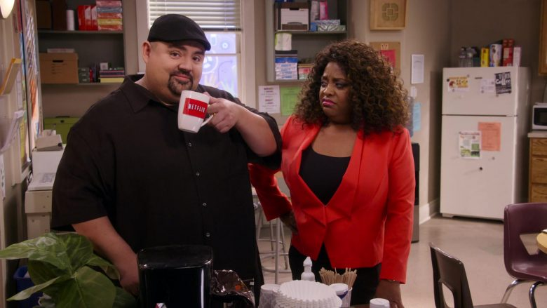 "Netflix Mug Held by Gabriel Iglesias in Mr. Iglesias - Season 1, Episode 10, ""Academic Decathlon"" (2019) - TV Show Product Placement"
