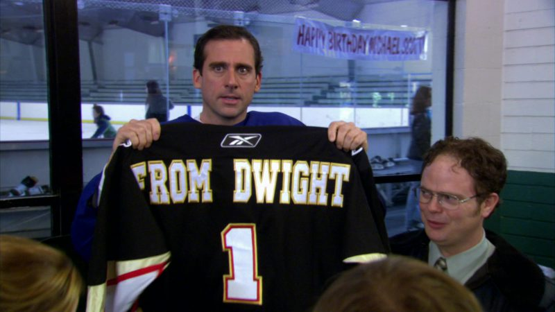 """Reebok Jersey Held by Steve Carell (Michael Scott) in The Office – Season 2, Episode 19, """"Michael's Birthday"""" (2006) - TV Show Product Placement"""