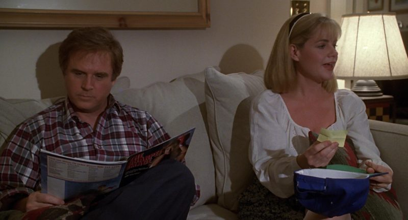 The Sharper Image Catalog Held by Charles Grodin in Beethoven (1992) - Movie Product Placement