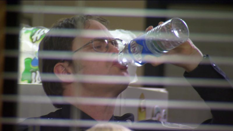 "Trinity Bottled Water Held by Rainn Wilson (Dwight Schrute) in The Office – Season 2, Episode 20, ""Drug Testing"" (2006) TV Show Product Placement"