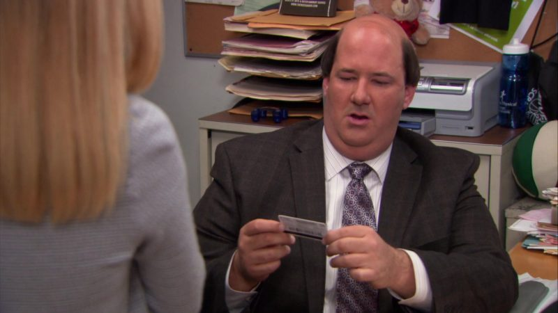 """iTunes Gift Card Held by Brian Baumgartner (Kevin Malone) in The Office – Season 9, Episodes 22-23, """"A.A.R.M."""" (2013) - TV Show Product Placement"""