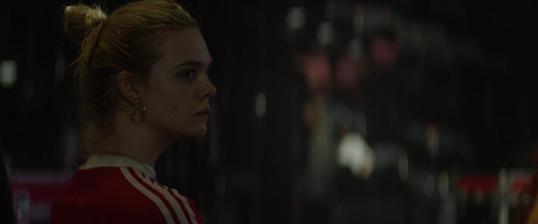 Elle Fanning in a red shirt