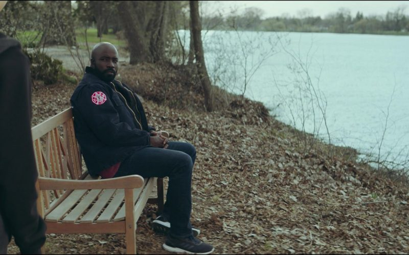 Mike Colter sitting on a bench