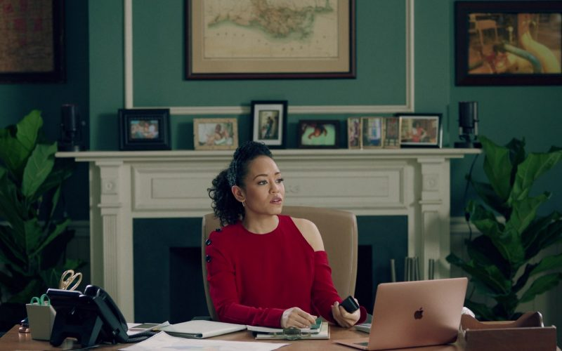 Dawn-Lyen Gardner sitting at a table using a laptop